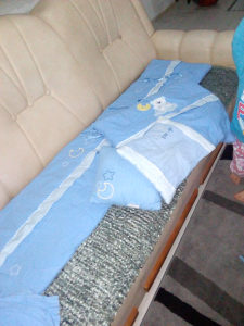 Posteljina i ogradica za krevetac
